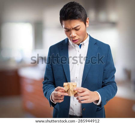 chinese man with a brain game - stock photo