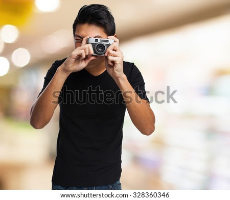 chinese man with a camera - stock photo