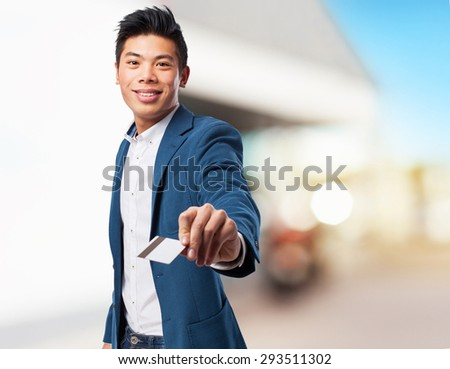 chinese man with credit card - stock photo