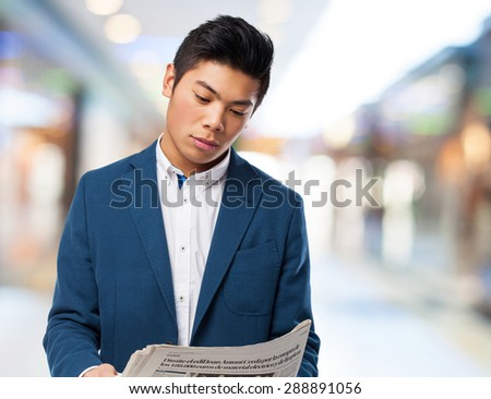 chinese man with newspaper