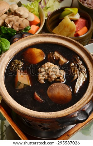 Chinese medicinal cuisine-Healthy herbs vegetarian pan  - stock photo