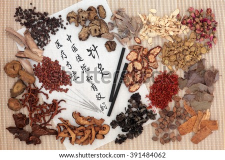 Chinese medicinal herb ingredients, acupuncture needles and moxa sticks  with calligraphy. Translation describes acupuncture chinese medicine as a traditional and effective medical solution. - stock photo