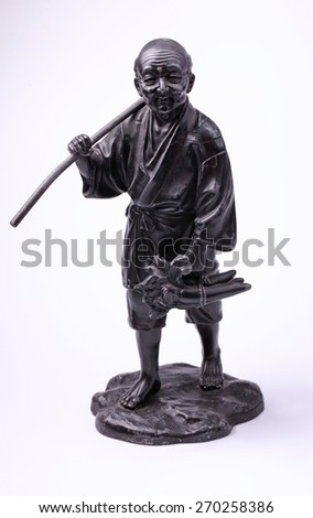 Chinese metal old man peasant statue on white background - stock photo