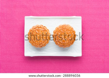 Chinese mid autumn festival foods. Traditional mooncakes on table setting.  - stock photo