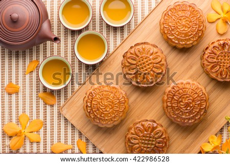Chinese mid autumn festival foods. Traditional mooncakes on table setting with teapot. & Chinese Mid Autumn Festival Foods Traditional Stock Photo (Royalty ...