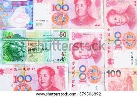 Chinese money Yuan and Hongkong dollars mixed together. Few different banknotes from Asia.