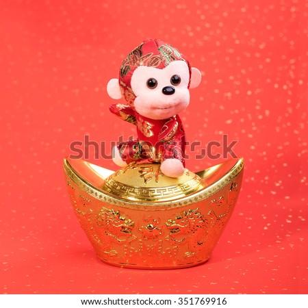 chinese monkey toy on red background - stock photo