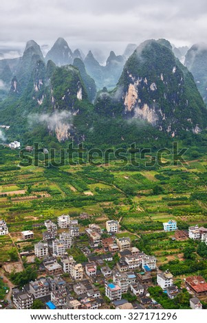 Chinese mountain landscape and village (Guilin, China)