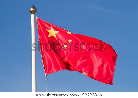 Chinese national flag with blue sky - stock photo