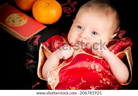 chinese new year baby with orange red packets with red chinese outfit - Chinese New Year Outfit