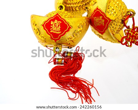 Chinese new year festival concept. A gold ingot  with text for Chinese new year decorations. - stock photo