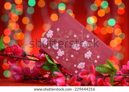 Chinese new year festival decorations, ang pow or red packet and plum flower.  - stock photo