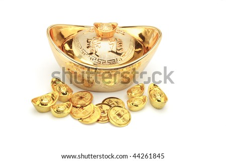 Chinese new year gold coins and ingots ornament on white - stock photo