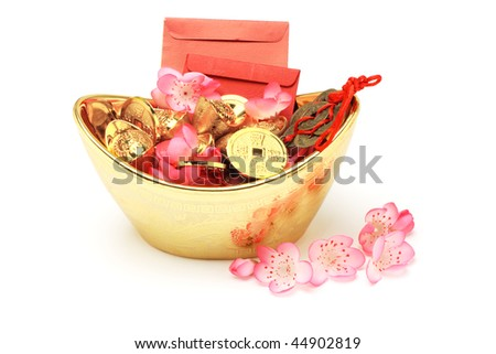 Chinese new year ornaments, red packets, gold ingots and coins on white background - stock photo