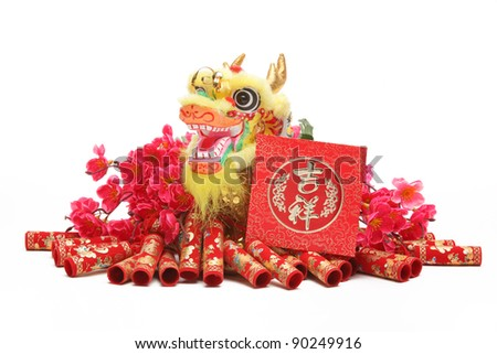 Chinese New Year Ornaments--Traditional Dancing Dragon,Red Packet and Firecrackers. - stock photo