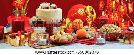 Chinese New Year party table in red and gold theme with food and traditional decorations & Chinese New Year Party Table Red Stock Photo (Royalty Free ...
