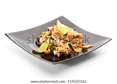 Chinese Noodles with Seadood and Vegetables. Garnished with Lime - stock photo