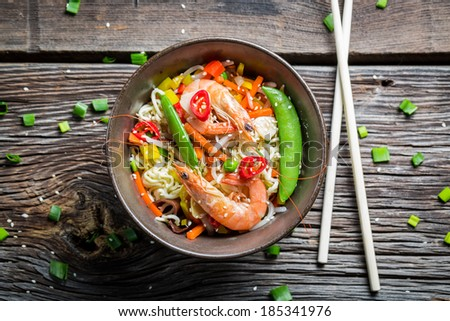 Chinese noodles with vegetables and prawns - stock photo