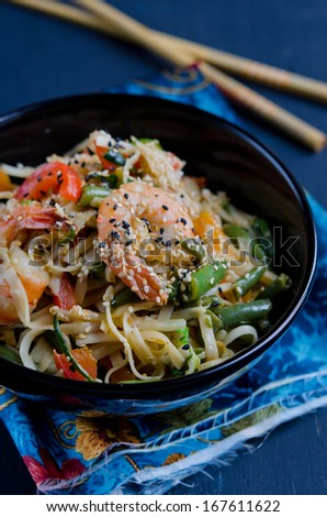 Chinese noodles with vegetables and  shrimp - stock photo