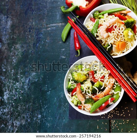 Chinese noodles with vegetables and shrimps. Food background - stock photo