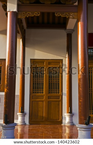 Chinese old wooden door in a ancient building,this style is used - stock photo