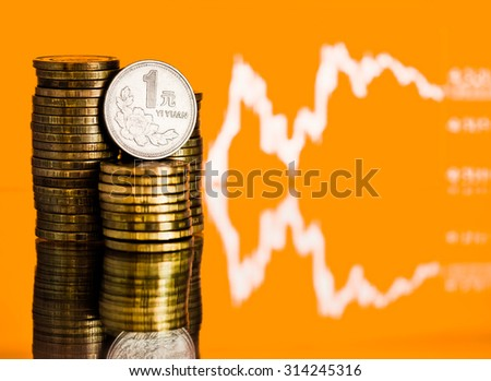 Chinese One Yuan Coin and gold money. Fluctuating graph on yellow background. Rate of the Chinese Yuan (shallow DOF)  - stock photo