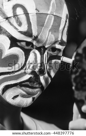 Chinese Opera Theatre; 12 May 1983, chinese man putting on his traditional make up in the backstage before the exhibition - EDITORIAL (FILM SCAN)