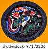 chinese ornament depicting a colorful peacock and flowers - stock photo