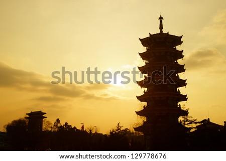 Chinese pagoda silhouette in Shanghai - stock photo