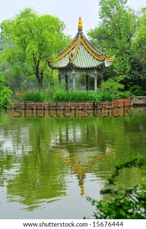 Chinese pagoda with reflection in water