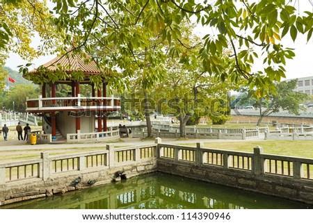 Chinese pavilion in garden - stock photo