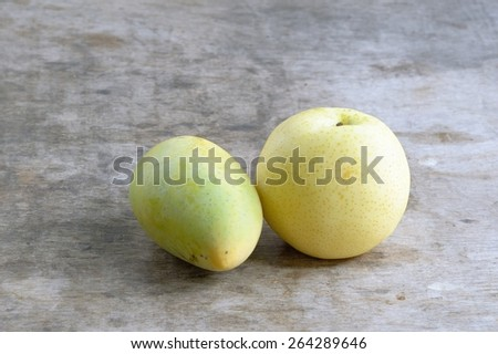 Chinese pear and Ripe Mango on wooden background /Chinese pear and Ripe Mango - stock photo