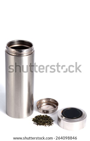 Chinese personal thermos with green tea leafs for traditional chinese drink isolated on white - stock photo