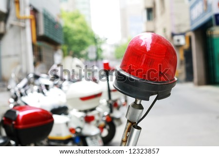Chinese policeman's  motorcycles with red lamp - stock photo