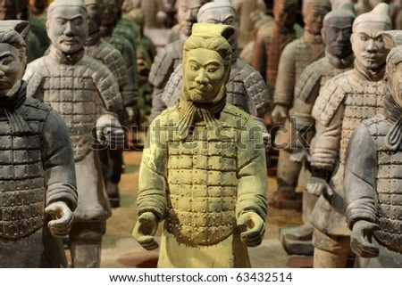 Chinese Qin warrior statues with one gold tinted in a crowd of grey. - stock photo