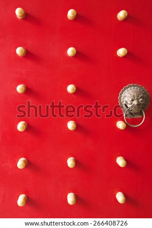 Chinese red door with lion's head knocker - stock photo