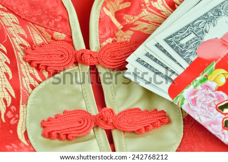 Chinese Red Packet and Qipao Traditional chinese dress or mandarin gown ,  lucky money packet. Chinese New Year - stock photo
