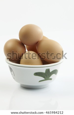 chinese rice bowl full of chicken eggs