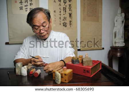 Chinese Seal engraver - stock photo