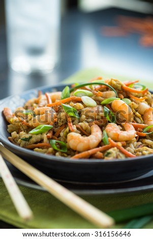Chinese shrimp chop suey with egg and brown rice - stock photo