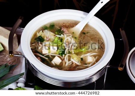 Chinese soup with tofu and noodles close up - stock photo