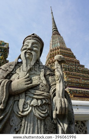 Chinese Statue Giant with pagoda at famous temple in Bangkok, Thailand. - stock photo