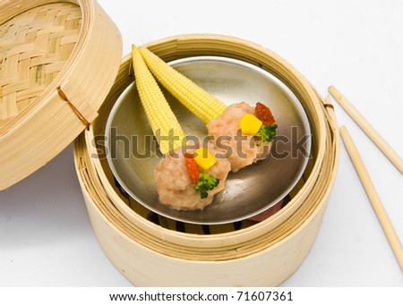 Chinese steamed dimsum corn in bamboo containers traditional cuisine