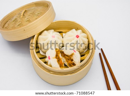 Chinese steamed dumpling  in bamboo containers traditional cuisine - stock photo