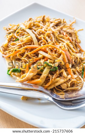 Chinese stir fried chicken egg noodle with bamboo shoot, carrot, and other vegetables