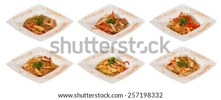 chinese stir-fried noodles set with chicken meat, seafood and sauses - stock photo