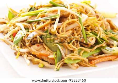 chinese stir-fried noodles with chicken - stock photo