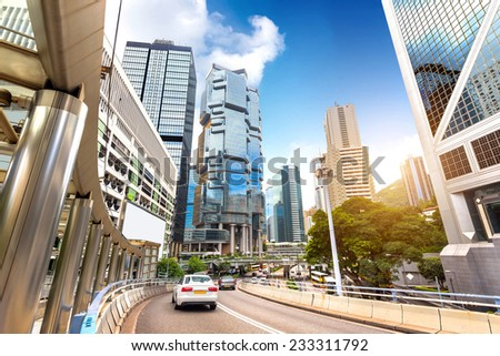 Chinese streets of Hong Kong steady stream of cars and skyscrapers - stock photo