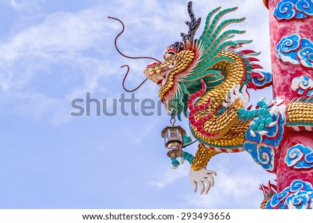 Chinese style dragon statue  and blue sky  in Chinese temple,Thailand ( Generality in Thailand ,and kind of art decorated in Buddhist church, temple pavilion ,temple hall . They are public) - stock photo