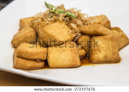 Chinese style fired tofu in plate. - stock photo